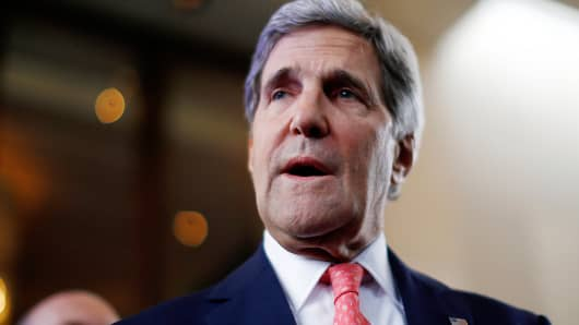 US Secretary of State John Kerry speaks to the press upon his arrival in Geneva on November 8, 2013.