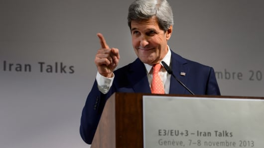 US Secretary of State John Kerry gestures during a press conference closing three days of talks on Iran's nuclear programme, on November 10, 2013 in Geneva.