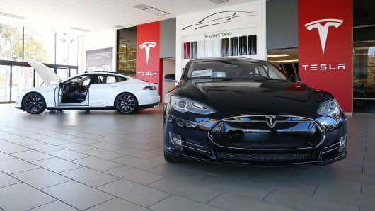 Tesla Model S cars are displayed at a Tesla showroom in Palo Alto, Calif.