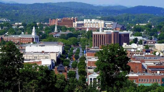 Kingsport, Tenn., and other U.S. cities are exporting more goods and services amid a shifting global economy. Downtown Broad Street beckons with the Appalachians' Clinch Mountain in the background.