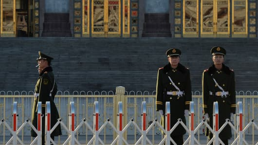 Chinese para-military police patrol beside the Great Hall of the People after the Communist Party Central Committee's concluded its secretive Third Plenum in Beijing on November 12, 2013.