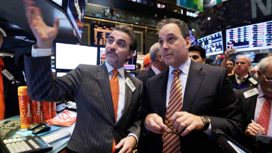 Chegg President and CEO Dan Rosensweig, right, meets with specialist Jason Blatt on the floor of the New York Stock Exchange, during its IPO, Nov. 13, 2013.