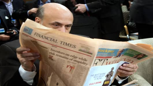 Federal Reserve Chairman Ben Bernanke reads the Financial Times during the annual International Monetary Fund meetings in Washington, October 12, 2013.