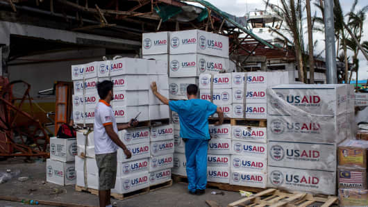 A relief worker looks over boxes of aid on November 14, 2013 in Leyte, Philippines.
