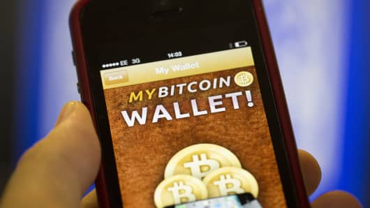 An Apple Inc. iPhone5 displays the Bitcoin Wallet smartphone app.