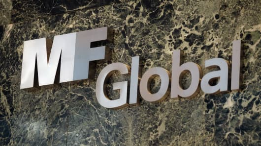 MF Global sign is seen in the office building where MF Global Holdings Ltd have offices in Manhattan on November 1, 2011 in New York.