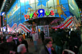 Pedestrians walk past a Toys 'R' Us Inc. store in New York.