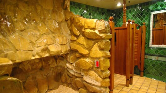 Madonna Inn restroom with waterfall urinal.