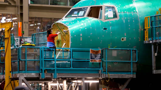 An employee works on the nose of a Boeing Co. 777 airplane at the company's facility in Everett, Washington.