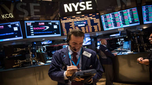 A trader works on the floor of the New York Stock Exchange on November 18, 2013.