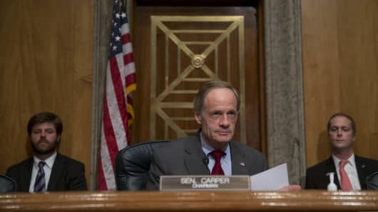 Senator Tom Carper, a Democrat from Delaware and chairman of the Homeland Security and Governmental Affairs Committee, arrives to a committee hearing in Washington, D.C., U.S., on Monday, Nov. 18, 2013