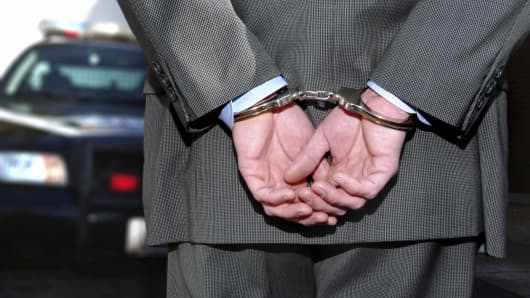 Handcuffs white collar crime