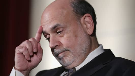 Federal Reserve Bank Chairman Ben Bernanke prepares to deliver the Herbert Stein Memorial Lecture during the National Economists Club Annual Dinner November 19, 2013 in Washington, DC.