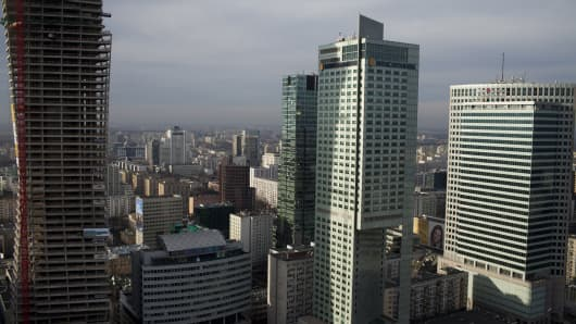 City skyscrapers are seen from the Palace of Culture and Science building on the skyline of Warsaw, Poland.