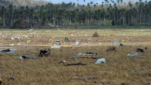 Debris blown off houses during Typhoon Haiyan litters a rice field in Hernani, in the central Philippines.