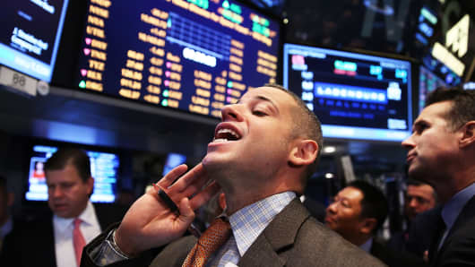 Trader on the floor of the New York Stock Exchange, November 22, 2013.
