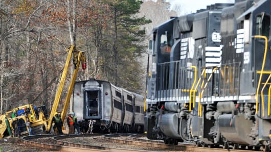 Workers remove cars of an Amtrak train after an accident in South Carolina, Nov. 25, 2013.