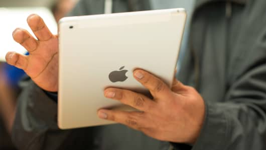 A customer tries out the new Apple Inc. iPad Air at the 5th Avenue Apple store in New York.