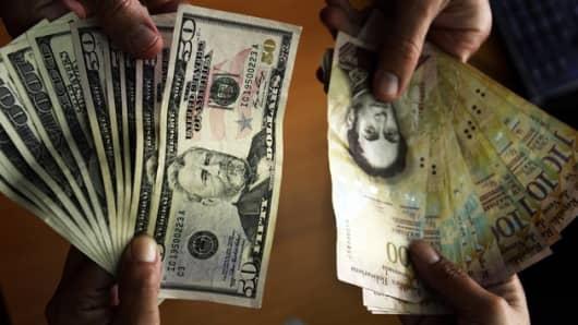 U.S. Dollars and Venezuelan Bolivares notes