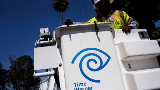 A field technician for Time Warner Cable, prepares to check a WiFi hotspot using a bucket truck in Manhattan Beach, California.
