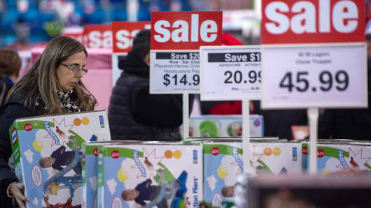 A woman shops for a bargains during the Thanksgiving holiday on November 28, 2013, at the Toys-R-Us store in Fairfax, Virginia.
