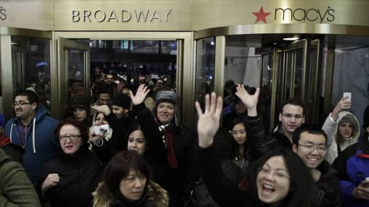 People enter Macy's Herald Square as the store opens its doors at 8 pm Thanksgiving day on November 28, 2013 in New York City.