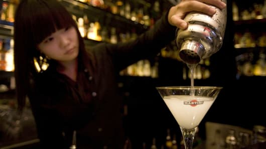 A bartender mixes a Gibson cocktail behind the counters at Dolce & Gabbana Martini Bar in Shanghai, China.