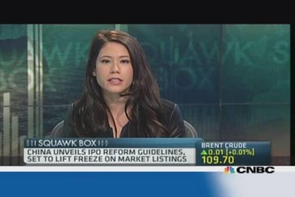 China to lift freeze on stock market listings