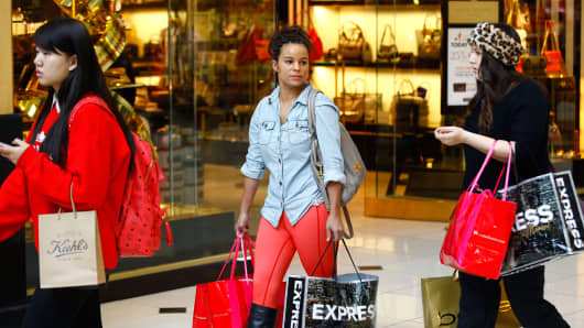 Shoppers walk with bags at the Somerset Collection shopping mall on November 29, 2013 in Troy, Michigan.