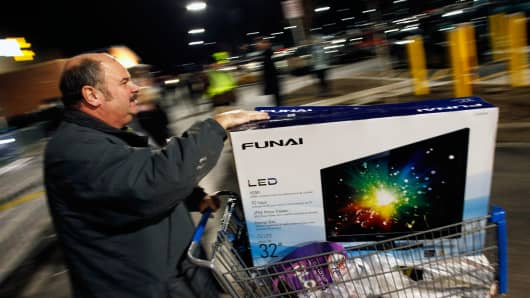 A customer leaves Wal-Mart with his purchased items on November 28, 2013 in Troy, Michigan.