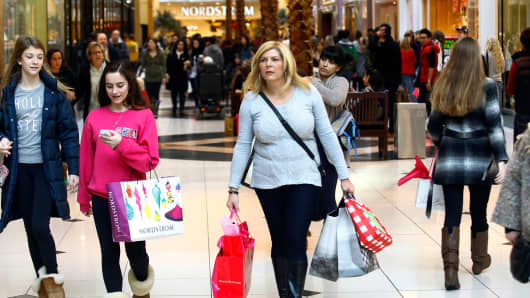 Shoppers carry their bags at Somerset Collection shopping mall on November 29, 2013 in Troy, Michigan.