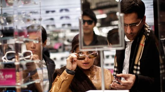 Customers shop for sun glasses at Macy's Herald Square on November 28, 2013 in New York City.