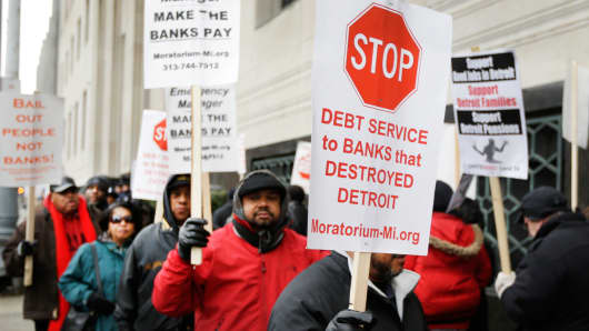Detroit city workers and supporters protest outside the federal courthouse in Detroit while awaiting the bankruptcy decision, Tuesday, Dec. 3, 2013.