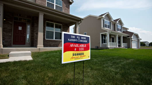 A sign stands outside a new home for sale in the D.R. Horton Inc. Cambridge at Southbury development in Oswego, Illinois.
