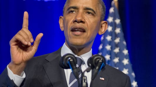President Barack Obama delivers remarks at an Organizing for Action 'Obamacare Summit' at the St. Regis Hotel.