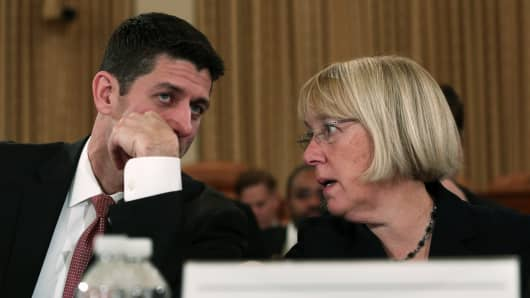 Rep. Paul Ryan (R-WI) (L) listens to Sen. Patty Murray (D-WA) (R) during a Conference on the FY2014 Budget Resolution meeting November 13, 2013 on Capitol Hill in Washington, DC.