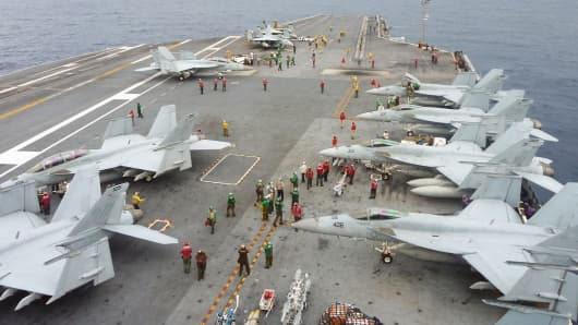 U.S. Navy FA-18 Hornets cram the flight deck of the USS George Washington during a joint military exercise with Japan in the Pacific Ocean near Japan's southernmost island of Okinawa Thursday, Nov. 28, 2013.