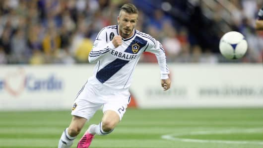 David Beckham No. 23 of the Los Angeles Galaxy chases after the ball during an MLS match against the Montreal Impact at the Olympic stadium.