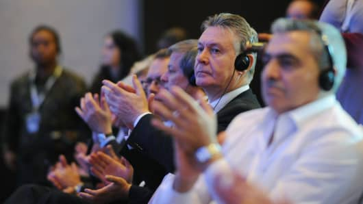 Union (EU) Commissioner Karel De Gucht (2nd R) applauds during the closing ceremony after success with final agreement of the WTO (World Trade Organisation) conference in Nusa Dua, on Indonesian resort island of Bali on December 7, 2013.