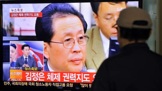 A South Korean man watches TV news about the alleged dismissal of Jang Song-Thaek, North Korean leader Kim Jong-Un's uncle, in Seoul on December 3, 2013.
