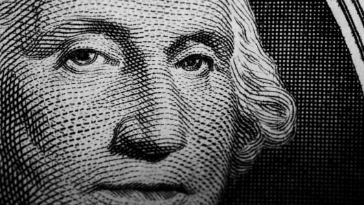 Close up detail of George Washington's portrait on the US one Dollar note.