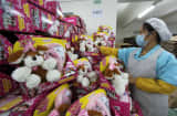This picture taken on December 7, 2013 shows a Chinese worker arranging the finished toys.