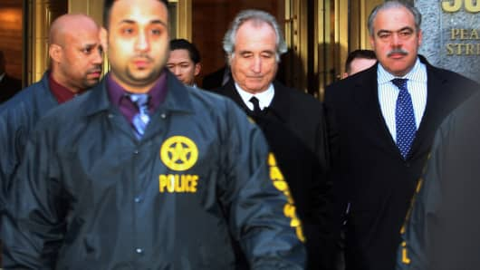 Bernard Madoff walks out of federal court after a bail hearing in New York on Jan. 5, 2009.