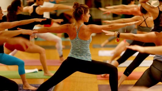 Amy Steiner leads a yoga class while dressed in Lululemon Athletica yoga clothes on Dec. 10, 2013, in Miami Beach.