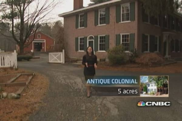 Million dollar homes: Antique colonial vs. mammoth manor