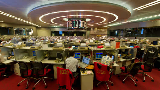 Traders work on the floor of the Hong Kong Stock Exchange on October 11, 2013.