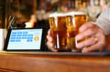 A terminal to accept payments using bitcoins is displayed on the bar at the Old Fitzroy pub on September 19, 2013 in Sydney, Australia.