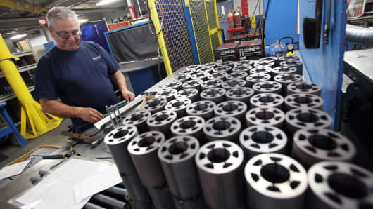 A worker checks pieces of finished product at the Sko-Die manufacturing facility in Morton Grove, Illinois.