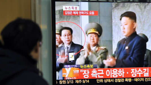 A South Korean man watches TV news about the alleged dismissal of Jang Song-Thaek, North Korean leader Kim Jong-Un's uncle, at a railway station in Seoul on December 3, 2013.