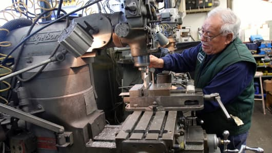 A worker manufactures parts to be used in coffee grinders assembled at the MPE Corporation facility in Chicago.